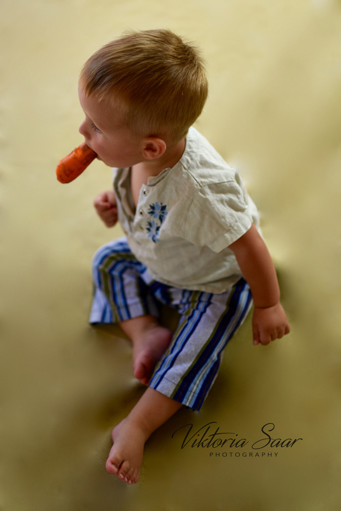 Baby boy with carrot Easter theme photo sessioon